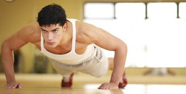 man_doing_push-ups_in_a_fitness_studio_pe0001219-e1341504765251-629x321